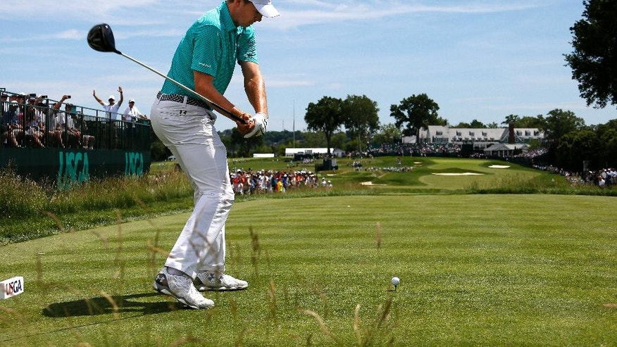Defending U.S. Open Champion Jordan Spieth hits from the 18th tee during a practice round for the 2016 US Open golf championship at Oakmont Country Club in Oakmont, Pa., Monday, June 13, 2016. (AP Photo/Gene J. Puskar)