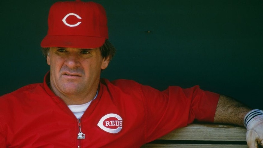 CINCINNATI - UNDATED: Pete Rose #14 of the Cincinnati Reds observes batting practice from the dugout at Riverfront Stadium during the 1980s in Cincinnati, Ohio. (Photo by Focus on Sport/Getty Images)