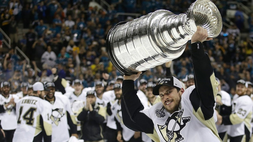 June 12, 2016: Pittsburgh Penguins center Sidney Crosby raises the Stanley Cup after Game 6 of the Stanley Cup Final against the San Jose Sharks.