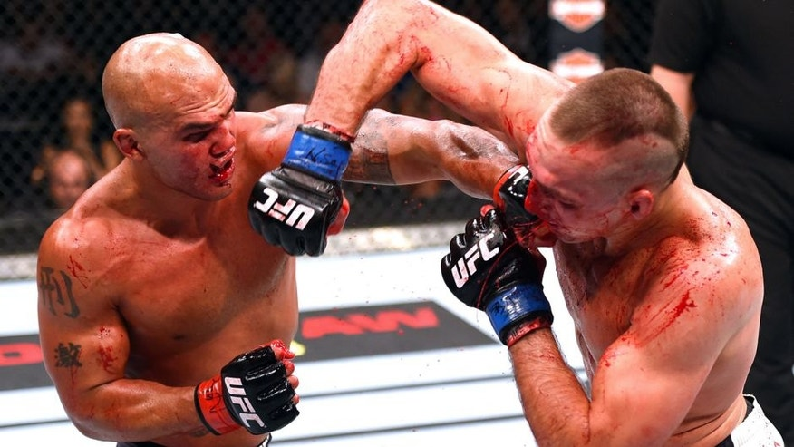 LAS VEGAS, NV - JULY 11: (L-R) Robbie Lawler punches Rory MacDonald in their UFC welterweight title fight during the UFC 189 event inside MGM Grand Garden Arena on July 11, 2015 in Las Vegas, Nevada. (Photo by Josh Hedges/Zuffa LLC/Zuffa LLC via Getty Images)
