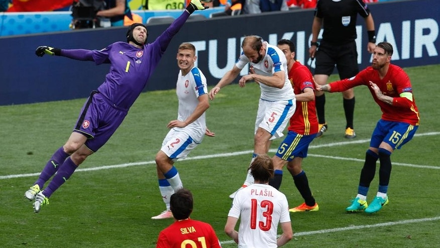 Czech Republic goalkeeper Petr Cech, left, makes a save during the Euro 2016 Group D soccer match between Spain and the Czech Republic at the Stadium municipal in Toulouse, France, Monday, June 13, 2016. (AP Photo/Hassan Ammar)