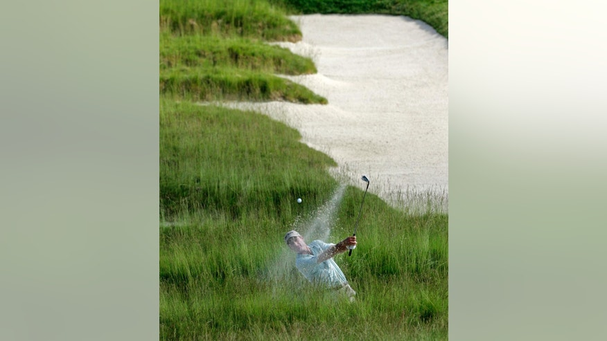 "ADVANCE FOR WEEKEND EDITIONS, JUNE 11-12 - In this June 14, 2007, file photo, Jim Furyk chips out of the Church Pews bunker onto the third fairway during the first round of the 107th U.S. Open Golf Championship at the Oakmont Country Club in Oakmont, Pa. ""I look forward to playing probably my last major in my home state,"" said Furyk, who grew up in Pennsylvania. The U.S. Open returns to Oakmont, perhaps the most storied, and feared, championship golf course in America. (AP Photo/Charles Krupa, File0"