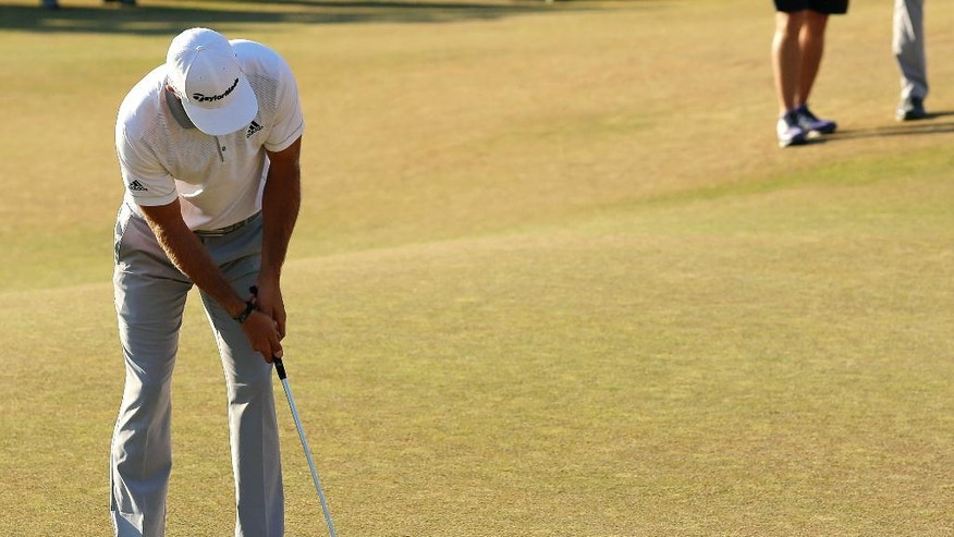 FILE - In this June 21, 2015, file photo, Dustin Johnson three-putts on the 18th hole during the final round of the U.S. Open golf tournament at Chambers Bay in University Place, Wash. Johnson lost to Jordan Spieth by one shot.  (AP Photo/Lenny Ignelzi, File)