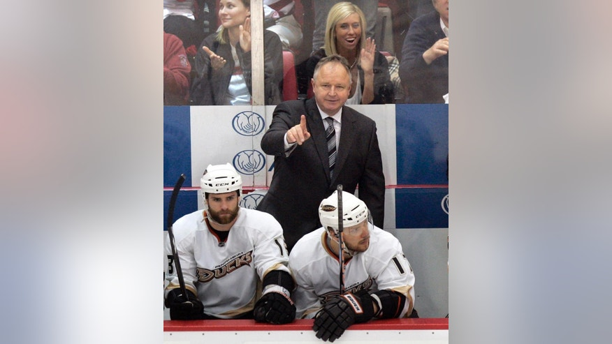 FILE - In this May 10, 2009, file photo, Anaheim Ducks head coach Randy Carlyle gestures during the second period of Game 5 of a second-round NHL hockey playoff series in Detroit. The Ducks re-hired Randy Carlyle on Tuesday, June 14, 2016, welcoming back the franchise's only Stanley Cup-winning coach 4 1/2 years after firing him. Carlyle replaces Bruce Boudreau, who replaced Carlyle on Nov. 30, 2011, early in Carlyle's seventh season in charge of the Ducks. (AP Photo/Carlos Osorio, File)