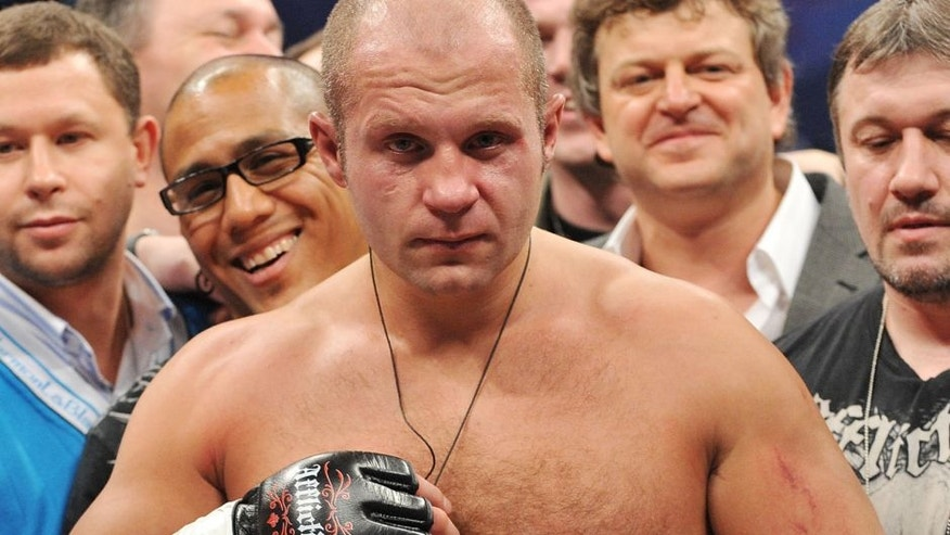 """ANAHEIM, CA - JANUARY 24: Affliction Fedor Emelianenko celebrates after defeating Andrei Arlovski in the first round during their Heavyweight bout at """"Affliction M-1 Global Day of Reckoning"""" at the Honda Center on January 24, 2009 in Anaheim, California. (Photo by Jon Kopaloff/Getty Images) *** Local Caption *** Fedor Emelianenko"""