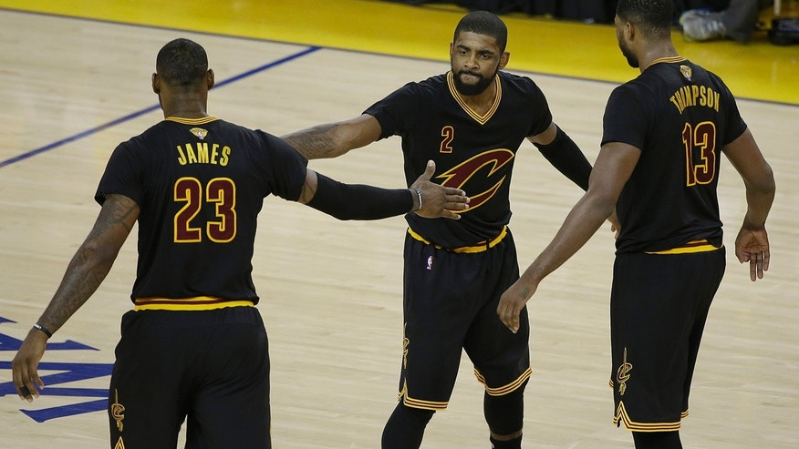 June 13, 2016: Cleveland Cavaliers guard Kyrie Irving (2), forward LeBron James (23) and center Tristan Thompson (13) react during the second half of Game 5 of the NBA Finals against the Golden State Warriors.