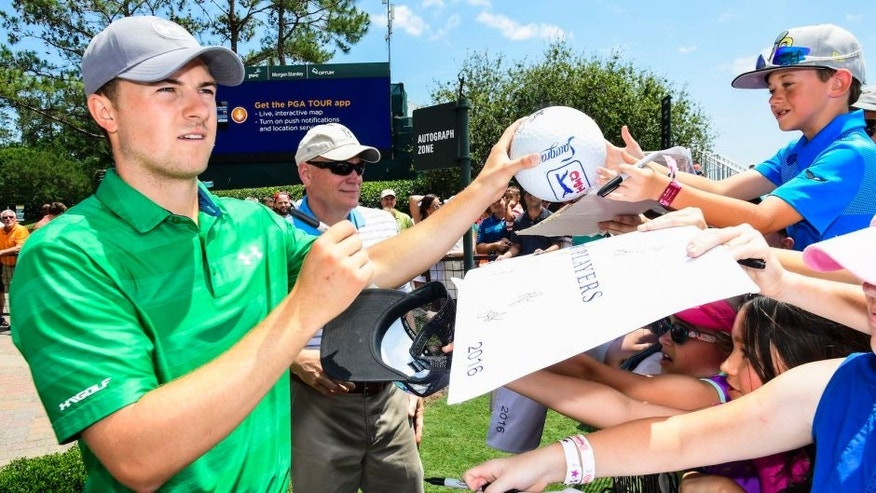 PONTE VEDRA BEACH, FL - MAY 10: Jordan Spieth signs autographs for fans ahead of THE PLAYERS Championship on THE PLAYERS Stadium Course at TPC Sawgrass on May 10, 2016. (Photo by Ryan Young/PGA TOUR)