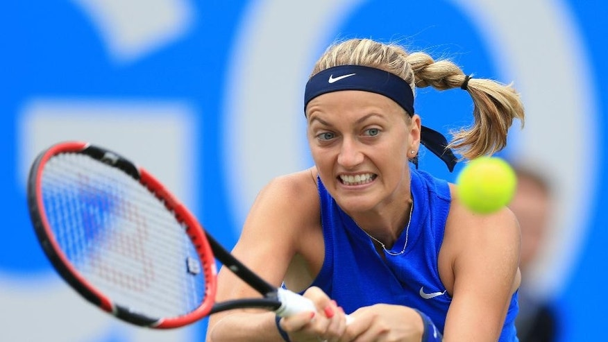 Czech Republic's Petra Kvitova  plays a return  fellow countrywoman Lucie Safarova during day two of the Birmingham Classic women's tennis tournament at the Edgbaston Priory, Birmingham. central England Tuesday June 14, 2016. (Nigel French/PA via AP) UNITED KINGDOM OUT