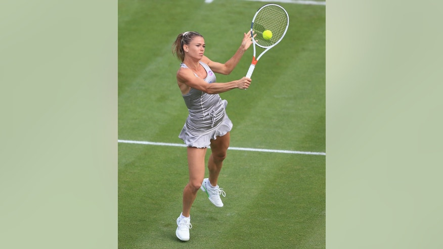 Italy's Camila Giorgi during day one of the 2016 Classic Tennis tournament at the Edgbaston Priory, Birmingham, England, Monday June 13, 2016. (Nigel French/PA via AP)  UNITED KINGDOM OUT