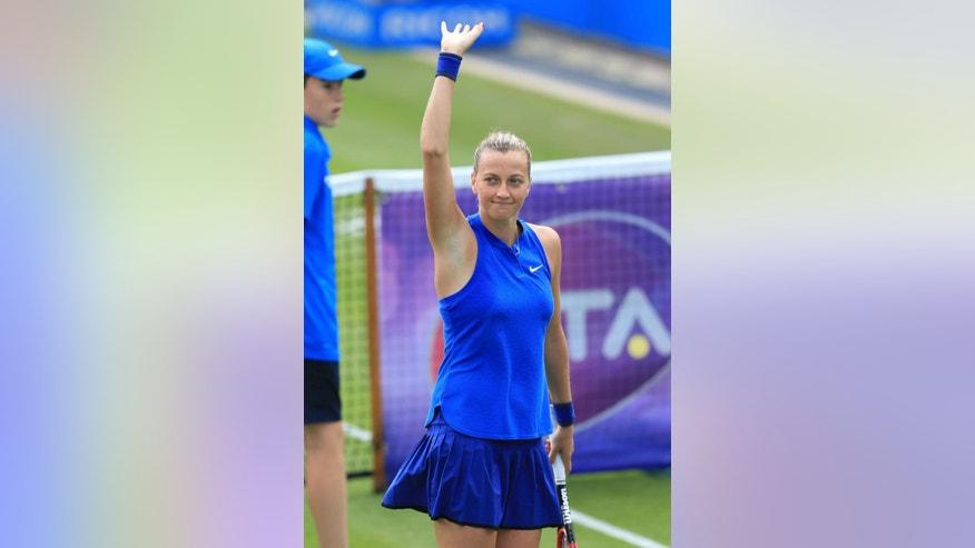 Czech Republic's Petra Kvitova celebrates her victory over fellow countrywoman Lucie Safarova during day two of the Birmingham Classic women's tennis tournament at the Edgbaston Priory, Birmingham. central England Tuesday June 14, 2016. (Nigel French/PA via AP) UNITED KINGDOM OUT