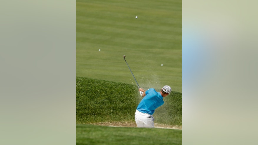 Danny Willett, of England, hits out of the bunker on the 12th hole during a practice round for the U.S. Open golf championship at Oakmont Country Club on Tuesday, June 14, 2016, in Oakmont, Pa. (AP Photo/Charlie Riedel)