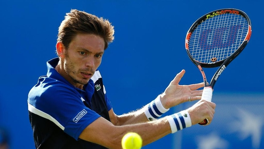 France's Nicolas Mahut plays a return to Britain's Andy Murray on day two of the Queen's grass-court tennis tournament in London, Tuesday June 14, 2016. (Steve Paston/PA via AP) UNITED KINGDOM OUT