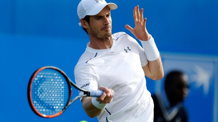 Britain's Andy Murray plays a return to France's Nicolas Mahut on day two of the Queen's grass-court tennis tournament in London, Tuesday June 14, 2016. (Steve Paston/PA via AP) UNITED KINGDOM OUT