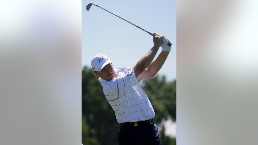 Ernie Els, of South Africa,watches his tee shot on the fifth hole during a practice round for the U.S. Open golf championship at Oakmont Country Club on Tuesday, June 14, 2016, in Oakmont, Pa. (AP Photo/John Minchillo)