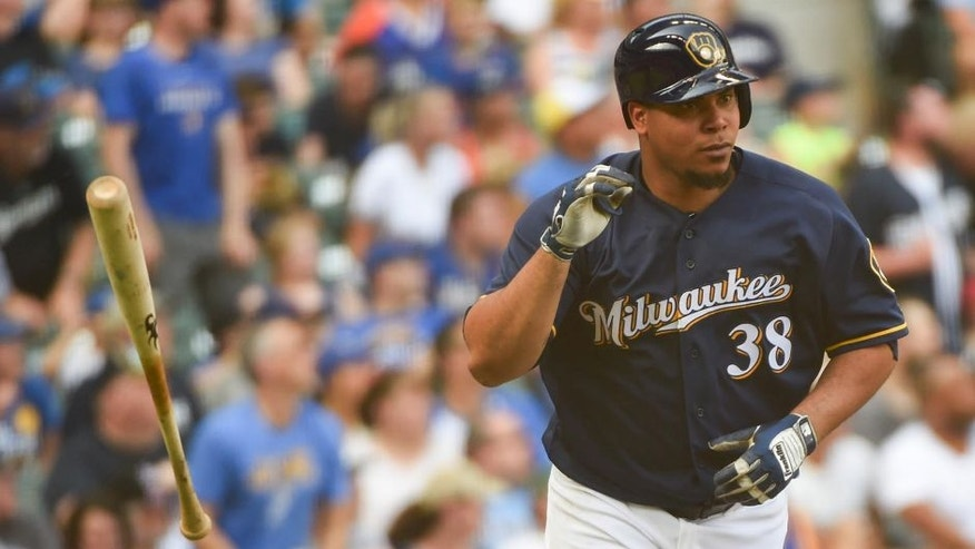 Jun 11, 2016; Milwaukee, WI, USA; Milwaukee Brewers pitcher Wily Peralta (38) flips his bat after hitting a two run home run in the fourth inning against the New York Mets at Miller Park. Mandatory Credit: Benny Sieu-USA TODAY Sports