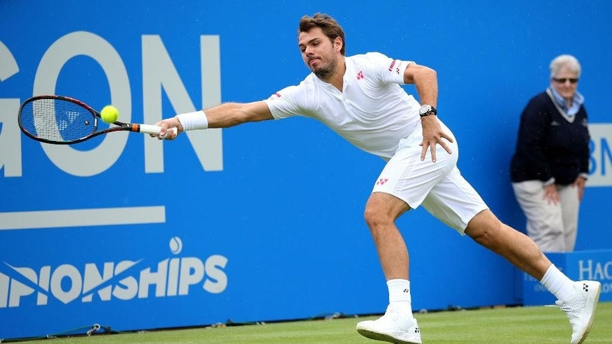 Switzerland's Stan Wawrinka returns the ball to Spain's Fernado Verdasco on day two of the Queen's grass-court tennis tournament in London, Tuesday June 14, 2016. (Steve Paston/PA via AP) UNITED KINGDOM OUT