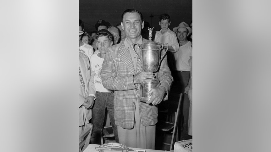 FILE - In this June 16, 1951, file photo, Ben Hogan holds the trophy after he won the U.S. Open golf tournament in Birmingham, Mich. With due respect to Johnny Miller and his 63 at Oakmont, one can make an argument that the greatest closing round in U.S. Open history belongs to Hogan at Oakland Hills.  (AP Photo/File)