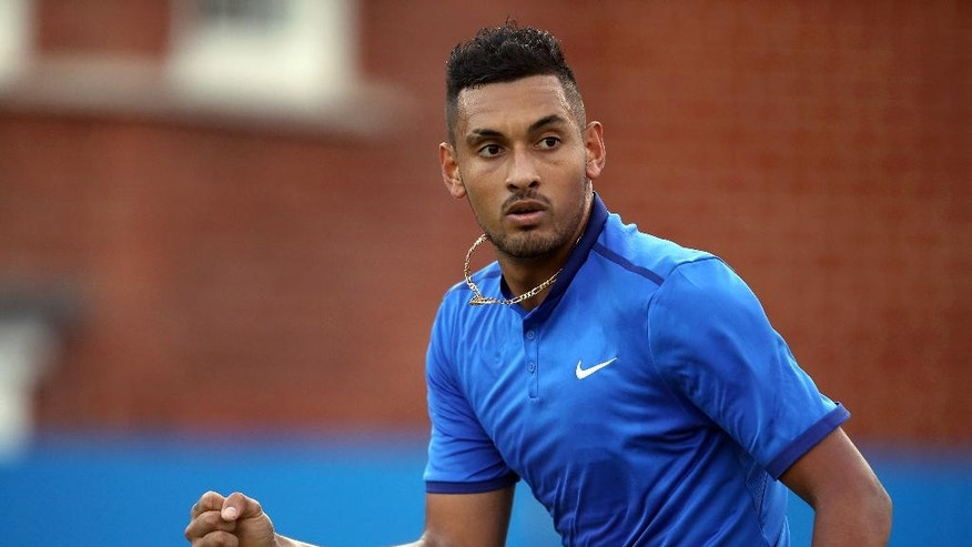 Australia's Nick Kyrgios gestures after winning a point against Canada's Milos Raonic on day two of the Queen's grass-court tennis tournament in London, Tuesday June 14, 2016. (Steve Paston/PA via AP) UNITED KINGDOM OUT