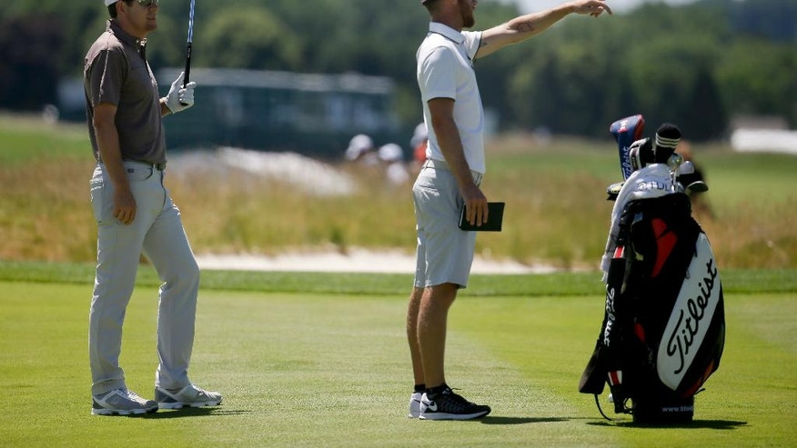 Aron Price, left, works with his caddie. Nick Flanagan on the third hole during a practice round for the U.S. Open golf championship at Oakmont Country Club on Tuesday, June 14, 2016, in Oakmont, Pa. (AP Photo/John Minchillo)