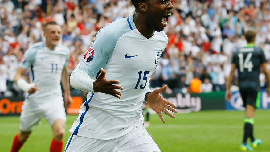 England's Daniel Sturridge celebrates after scoring his side's second goal during the Euro 2016 Group B soccer match between England and Wales at the Bollaert stadium in Lens, France, Thursday, June 16, 2016.  Behind is teammate Jamie Vardy. (AP Photo/Kirsty Wigglesworth)