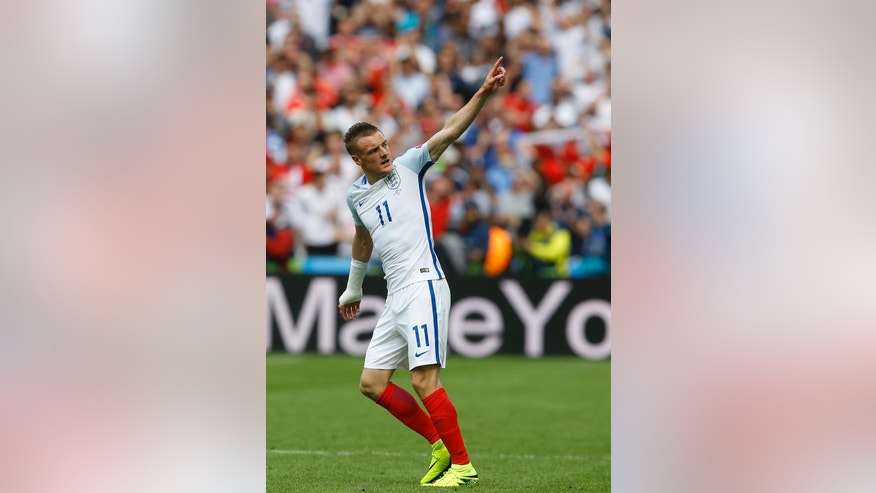 England's Jamie Vardy celebrates after scoring his side's first goal during the Euro 2016 Group B soccer match between England and Wales at the Bollaert stadium in Lens, France, Thursday, June 16, 2016. (AP Photo/Kirsty Wigglesworth)