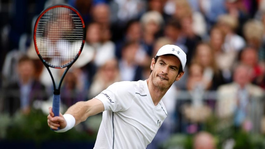 Britain's Andy Murray returns the ball to his compatriot Aljaz Bedene during day four of the 2016 tennis Championships at The Queen's Club, London, Thursday, June 16, 2016. (Steve Paston/PA via AP) UNITED KINGDOM OUT