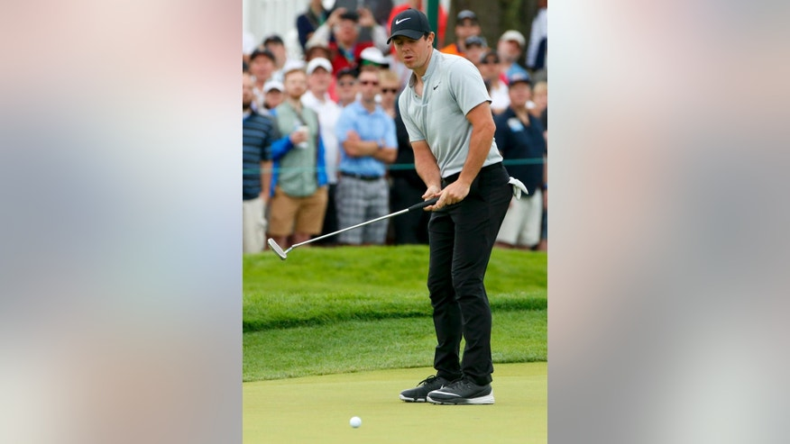 Rory McIlroy, of Northern Ireland, reacts to his putt on the thrid hole during the first round of the U.S. Open golf championship at Oakmont Country Club on Thursday, June 16, 2016, in Oakmont, Pa. (AP Photo/Gene J. Puskar)