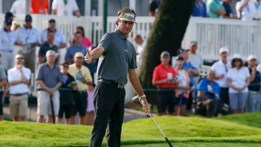 Bubba Watson reacts to his missed putt on the third hole during the first round of the U.S. Open golf championship at Oakmont Country Club on Thursday, June 16, 2016, in Oakmont, Pa. (AP Photo/Gene J. Puskar)