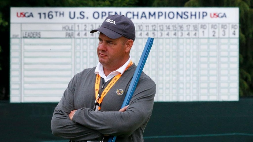 "Darin Bevard with the USGA holds a ""Stimpmeter"" at the U.S. Open golf championship at Oakmont Country Club on Wednesday, June 15, 2016, in Oakmont, Pa. It's called a ""Stimpmeter"" in honor of inventor Edward S. Stimpson and in a nice bit of serendipity, the device traces its origins back to storied Oakmont Country Club, site of this season's second major. No matter how much golfers bellyache during the week, the ramp, slightly less than 2 inches wide, will have the last word on how fast the greens are running. (AP Photo/Gene J. Puskar)"