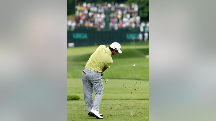 Andrew Landry hits his tee shot on the sixth hole during the first round of the U.S. Open golf championship at Oakmont Country Club on Thursday, June 16, 2016, in Oakmont, Pa. (AP Photo/Charlie Riedel)