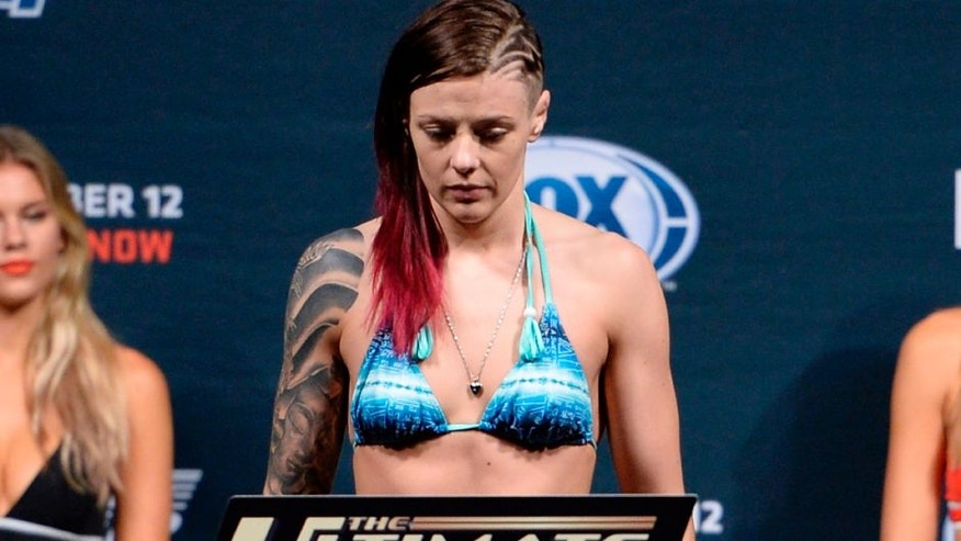 LAS VEGAS, NEVADA - DECEMBER 11: UFC strawweight Joanne Calderwood steps on the scale during The Ultimate Fighter Finale weigh-ins at the Palms Casino Resort on December 11, 2014 in Las Vegas, Nevada. (Photo by Jeff Bottari/Zuffa LLC/Zuffa LLC via Getty Images)