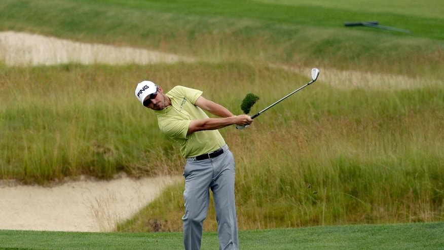Andrew Landry hits from the fairway on the third hole during the first round of the U.S. Open golf championship at Oakmont Country Club on Thursday, June 16, 2016, in Oakmont, Pa. (AP Photo/Charlie Riedel)