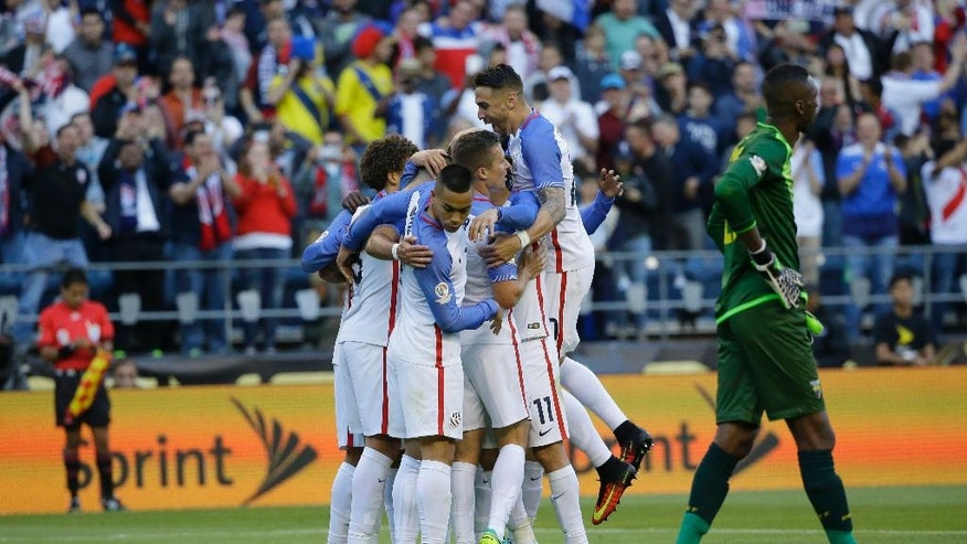 United States' players celebrate after Gyasi Zardes scored against Ecuador during a Copa America Centenario quarterfinal soccer match, Thursday, June 16, 2016 at CenturyLink Field in Seattle. The U.S. won the match 2-1. (AP Photo/Ted S. Warren)