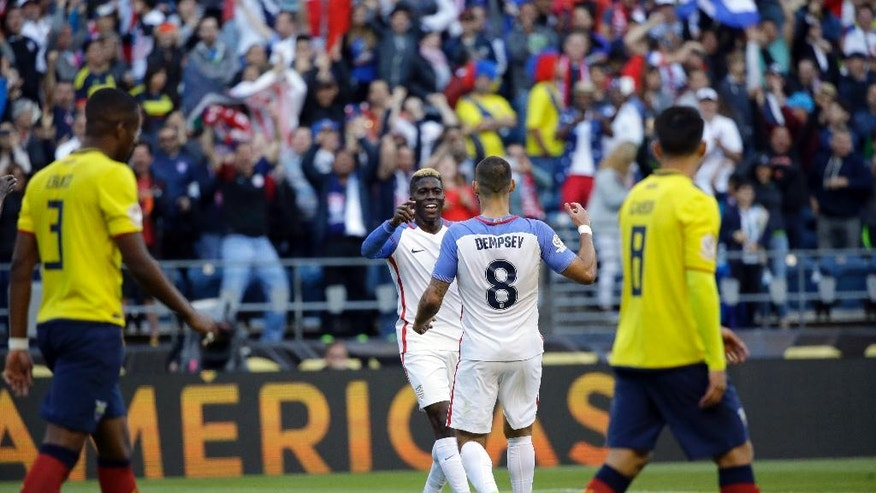 United States' Gyasi Zardes, center, is congratulated by Clint Dempsey, 8, after scoring his side's second goal against Ecuador during a Copa America Centenario quarterfinal soccer match, Thursday, June 16, 2016 at CenturyLink Field in Seattle. (AP Photo/Ted S. Warren)