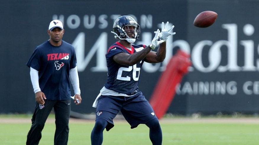 Jun 14, 2016; Houston, TX, USA; Houston Texans running back Lamar Miller (26) catches a short pass in offensive drills during Houston Texans minicamp at Methodist Training Center in Houston, TX. Mandatory Credit: Erik Williams-USA TODAY Sports