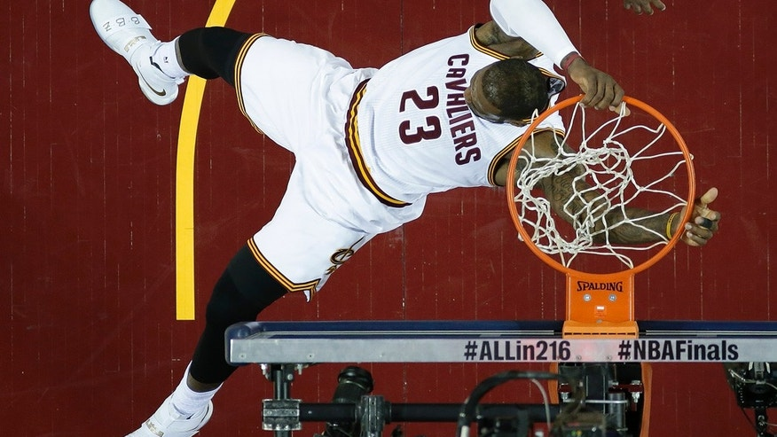 June 16, 2016: Cleveland Cavaliers forward LeBron James dunks against the Golden State Warriors during the first half of Game 6 of the NBA Finals in Cleveland
