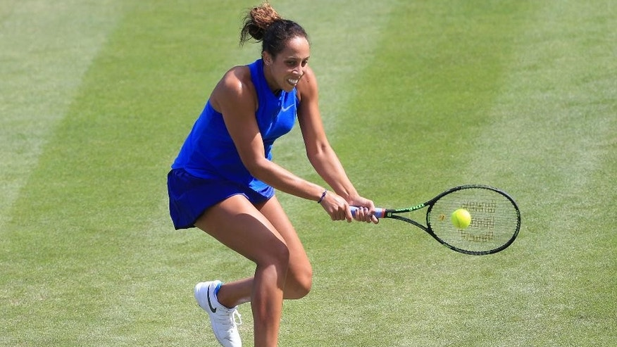 Madison Keys of the US returns the ball to Latvia's Jelena Ostapenko on day five of the Birmingham Classic women's tennis tournament at the Edgbaston Priory, Birmingham, central England, Friday June 17, 2016. (Tim Goode/PA via AP) UNITED KINGDOM OUT