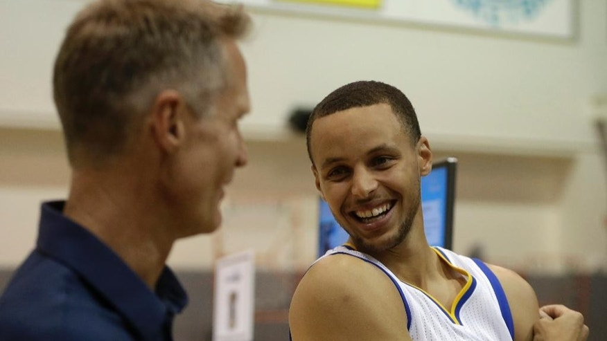 Golden State Warriors' Stephen Curry, right, with coach Steve Kerr.