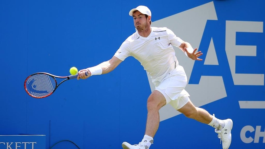Great Britain's Andy Murray plays a return to Britain's Kyle Edmund in the quarterfinal match of the 2016 tennis Championships at The Queen's Club, London, Friday June 17, 2016. (Steve Paston/PA via AP)  UNITED KINGDOM OUT