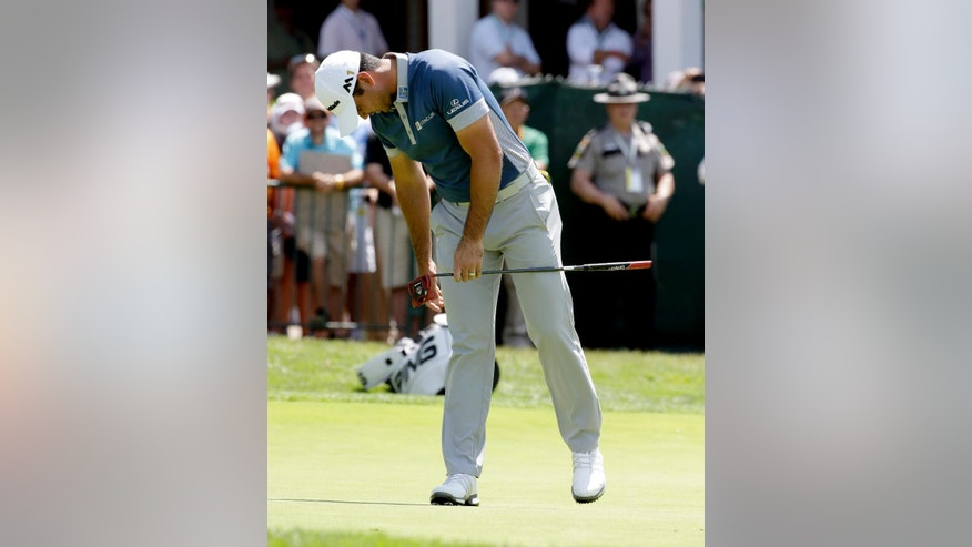 Jason Day, of Australia, reacts to his putt on the 18th hole during the rain delayed first round of the U.S. Open golf championship at Oakmont Country Club on Friday, June 17, 2016, in Oakmont, Pa. (AP Photo/Gene J. Puskar)