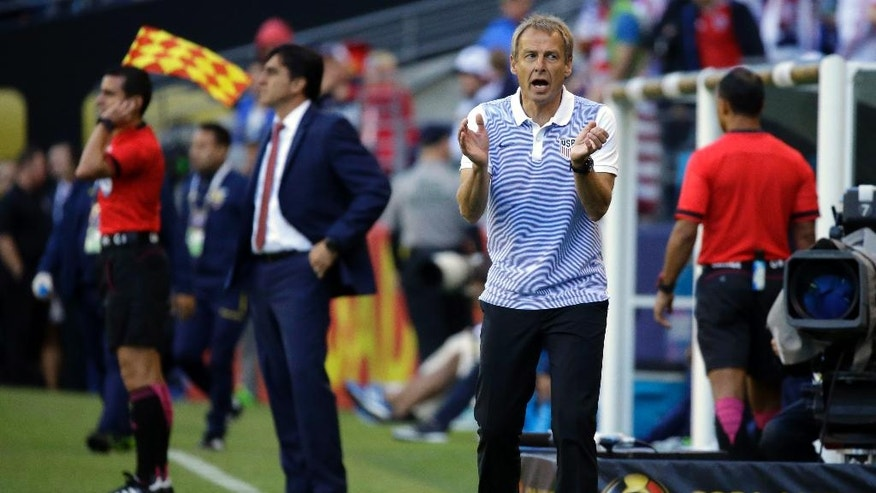 United States coach Jurgen Klinsmann, right, shouts encouragements to his team during the first half of a Copa America Centenario quarterfinal soccer match against Ecuador, Thursday, June 16, 2016 at CenturyLink Field in Seattle. (AP Photo/Ted S. Warren)