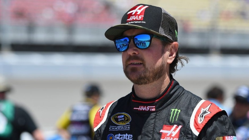 BROOKLYN, MI - JUNE 12: Kurt Busch, driver of the #41 Haas Automation/Monster Energy Chevrolet, stands on the grid prior to the NASCAR Sprint Cup Series FireKeepers Casino 400 at Michigan International Speedway on June 12, 2016 in Brooklyn, Michigan. (Photo by Josh Hedges/Getty Images )