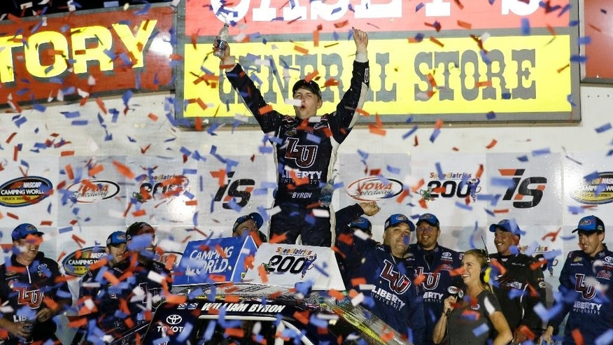 William Byron, center, celebrates in Victory Lane after winning the NASCAR Truck Series auto race, Saturday, June 18, 2016, at Iowa Speedway in Newton, Iowa. (AP Photo/Charlie Neibergall)