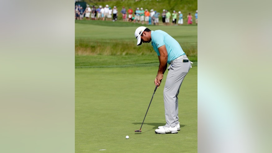 Jason Day, of Australia, putt on the 13th hole during third round of the U.S. Open golf championship at Oakmont Country Club on Saturday, June 18, 2016, in Oakmont, Pa. (AP Photo/Gene J. Puskar)