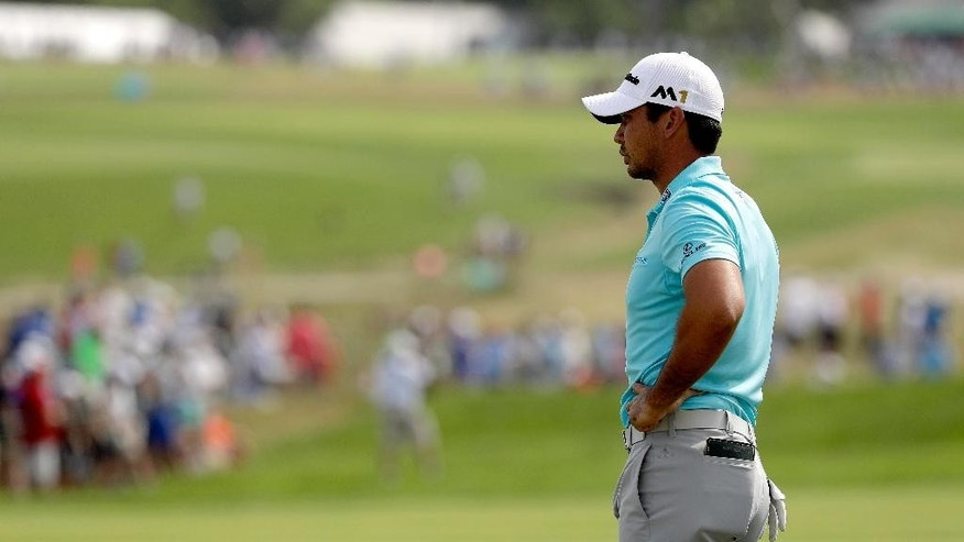 Jason Day, of Australia, waits to play on the 12th hole during third round of the U.S. Open golf championship at Oakmont Country Club on Saturday, June 18, 2016, in Oakmont, Pa. (AP Photo/Charlie Riedel)