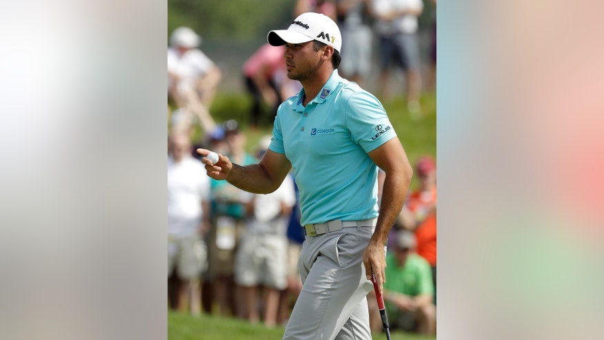 Jason Day, of Australia, reacts after making a birdie on the 12th hole during third round of the U.S. Open golf championship at Oakmont Country Club on Saturday, June 18, 2016, in Oakmont, Pa. (AP Photo/Charlie Riedel)