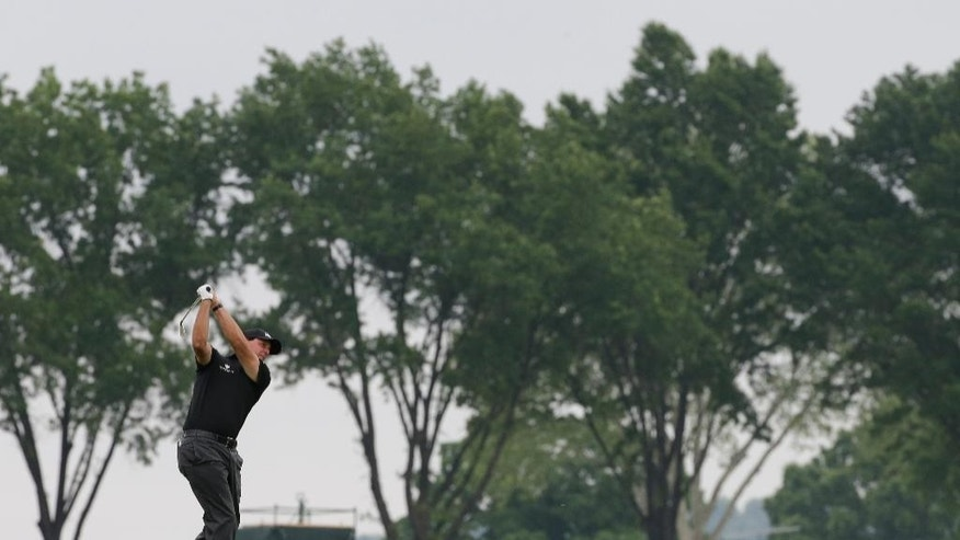 Phil Mickelson hits from rough on the 10th hole during the rain delayed first round of the U.S. Open golf championship at Oakmont Country Club on Friday, June 17, 2016, in Oakmont, Pa. (AP Photo/Gene J. Puskar)