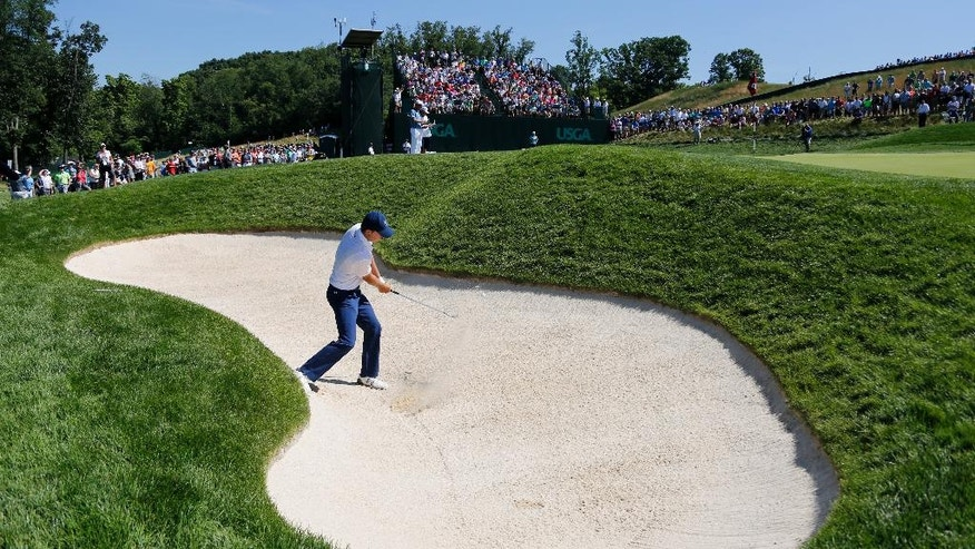 Jordan Spieth hits out of the bunker on the sixth hole during the rain delayed second round of the U.S. Open golf championship at Oakmont Country Club on Saturday, June 18, 2016, in Oakmont, Pa. (AP Photo/Gene J. Puskar)