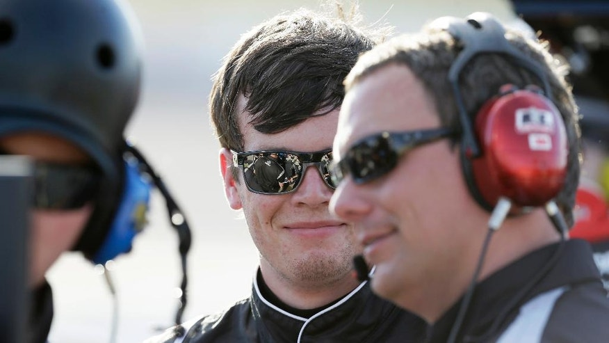 Erik Jones, center, reacts with crew members after winning the pole position for the NASCAR Xfinity Series auto race, Saturday, June 18, 2016, at Iowa Speedway in Newton, Iowa. (AP Photo/Charlie Neibergall)
