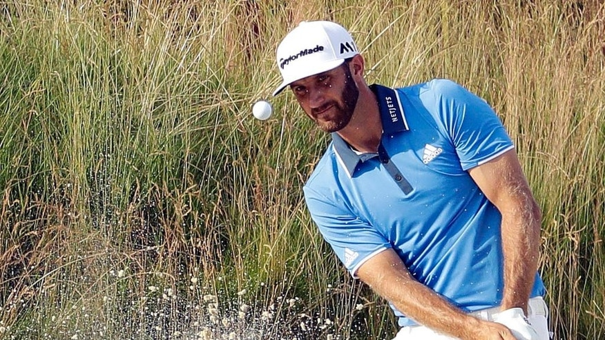 Dustin Johnson hits out of the bunker on the fifth hole during third round of the U.S. Open golf championship at Oakmont Country Club on Saturday, June 18, 2016, in Oakmont, Pa. (AP Photo/Charlie Riedel)